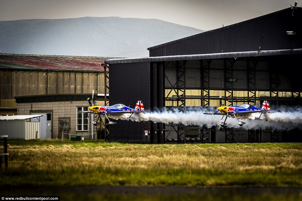 Two Planes Fly Through a Hangar