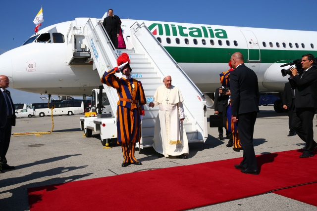 Pope Francis exiting an Alitalia plane.