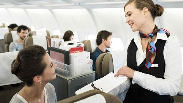 Flight Attendant Serving Customers