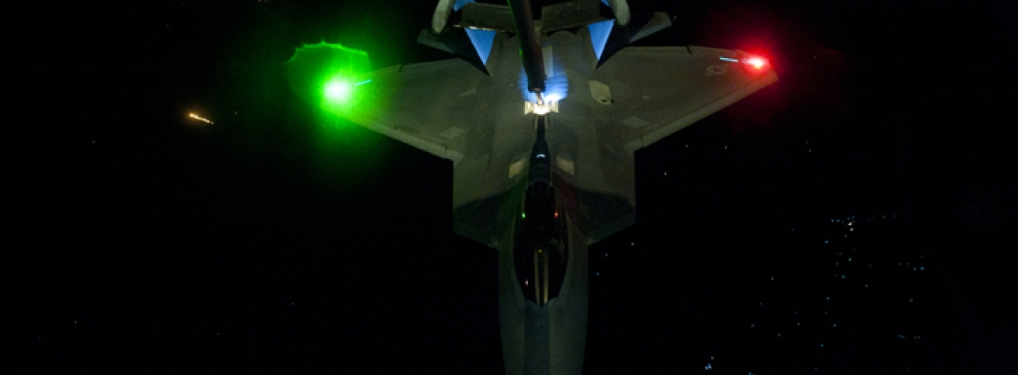 Super Cool Night Photos of the F-22 refueling mid-air enroute to Syria