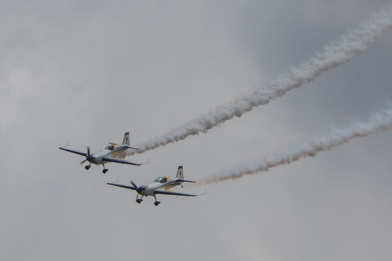 The Extra 330s fly formation at Avalon