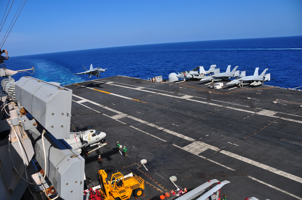 Military planes taking off from the aircraft carrier watch this