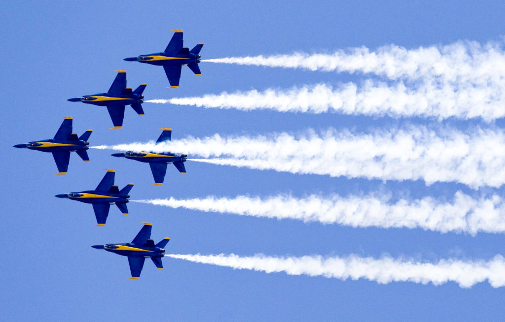 the blue angels fly over a beach