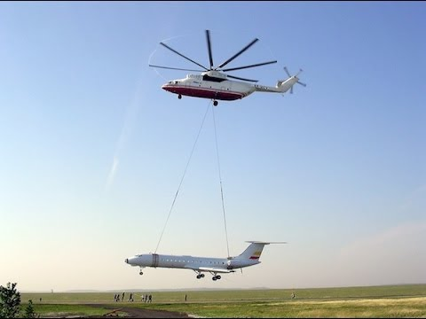 World's Largest Helicopter Mi-26 Moves a Jet