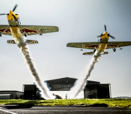 Red Bull Pilots Fly Through Hangar at 185mph