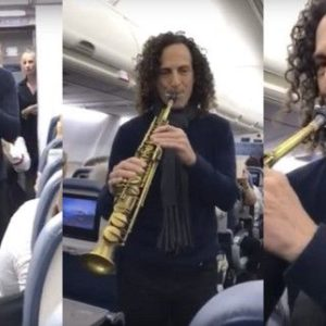 Grammy award winning saxophonist Kenny G plays for passengers
