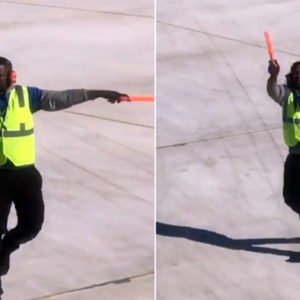 Dancing Airport Employee Entertains Travelers on Tarmac