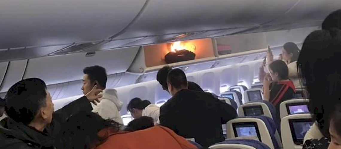 Flight Attendant Puts Out The Fire With A Bottle Of Water