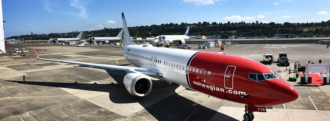 IAG takes a near 5% stake in Norwegian, weighs full offer