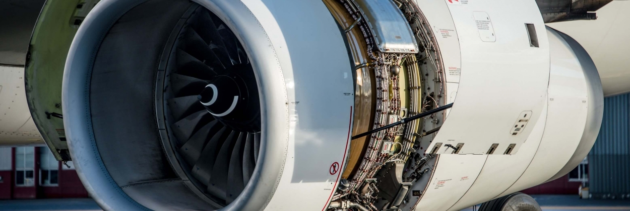 airliner engine with open cowlings for a engine check after maint