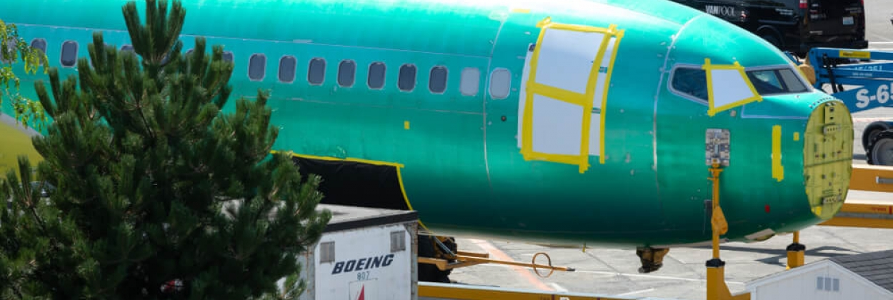 Boeing 737 MAX airliner on a train car outside the Renton factory