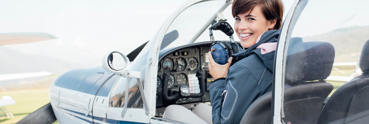 Female trainee pilot in a small aircraft