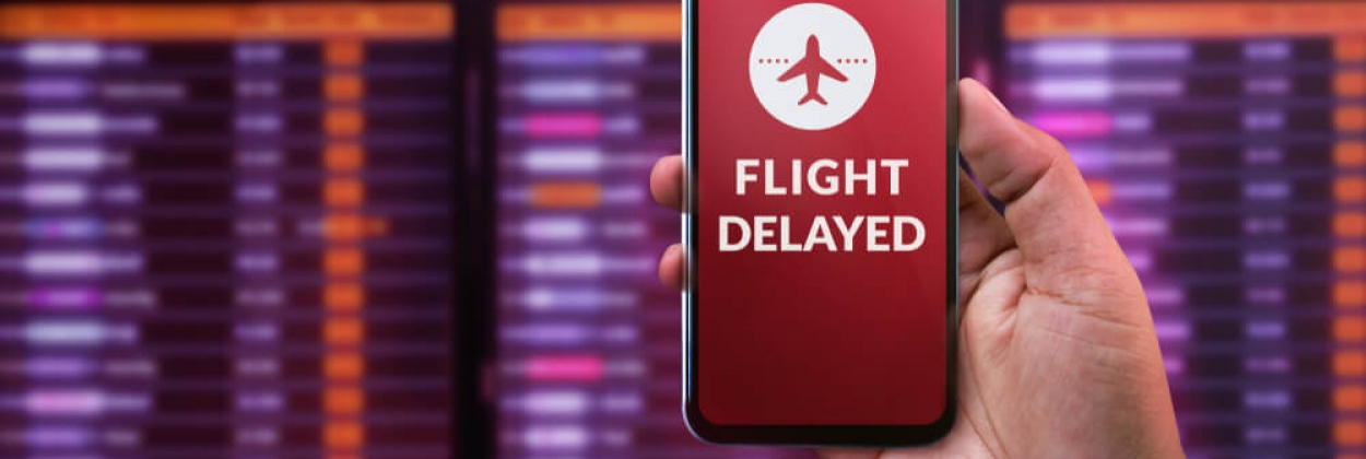Flight delayed sign on a mobile phone