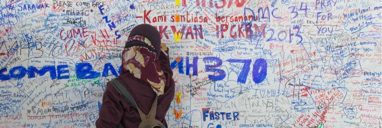 girl writes messages for Malaysia Airlines MH370 aerotime news