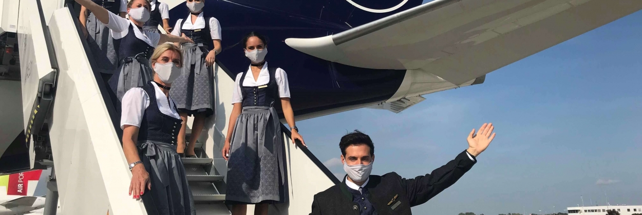 lufthansa crew in traditional trachten clothing
