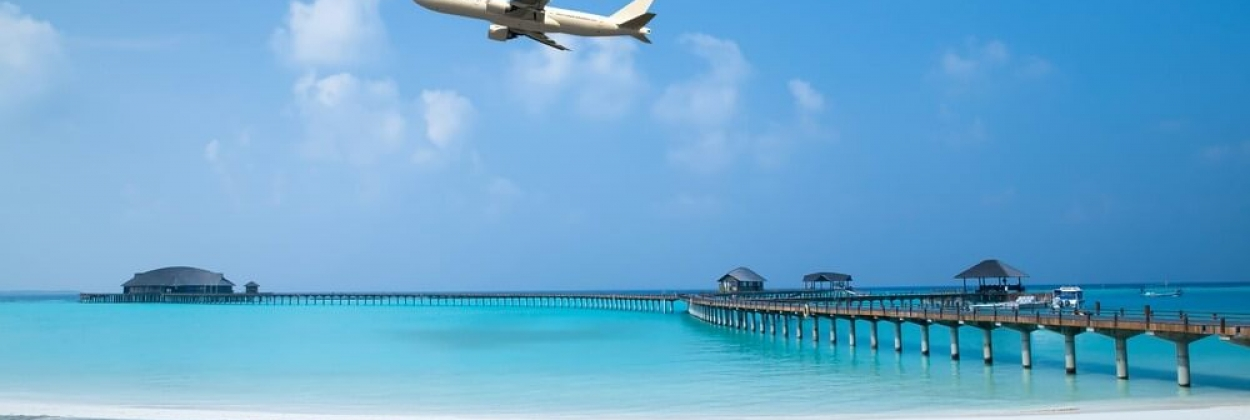 Aircraft flying over the beach in Maldives