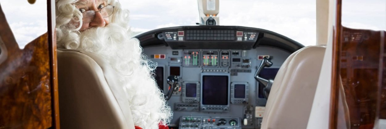 Santa Claus sitting in the cockpit of a private aircraft