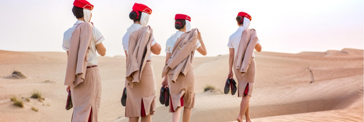Emirates flight attendants walking through desert aerotime news