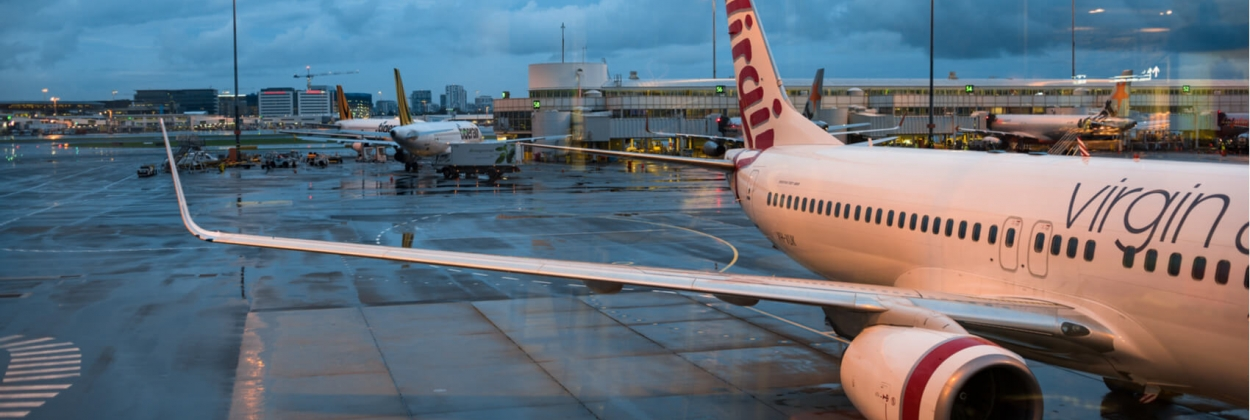 virgin australia aircraft on parking bay in sydney aerotime news