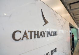 Cathay Pacific lowers profit forecast; passenger traffic shrinks