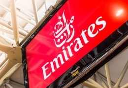 Emirates logo on an airport screen
