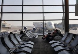 Empty airport with Etihad A380 in the background AeroTime News