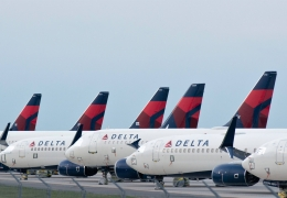 Delta Airplanes sit in a row at Kansas City International Airpor