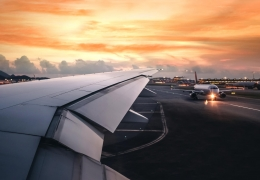 wing of an airplane taking off on runway aerotime news