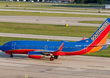 Southwest B737 skids off runway, nearly avoids slide onto highway