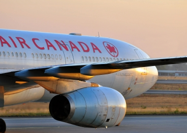 After third straight quarterly loss Air Canada cuts flights