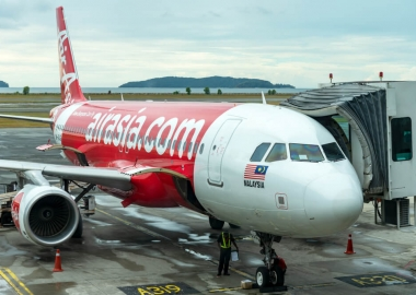 AirAsia Airbus A320 family aircraft parked in Kota Kinabalu Inter
