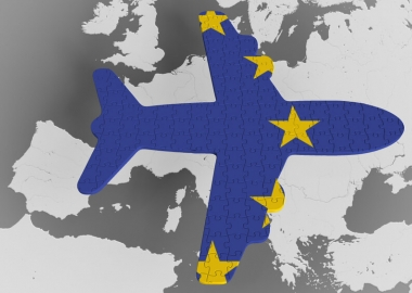 Aircraft with European Union flag above a map of Europe