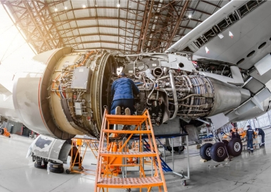 aviation mechanic working on an aircraft engine