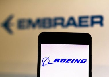 Boeing logo as the foreground for the Embraer logo
