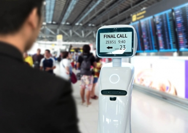 Passenger uses self driving check-in robots assistant