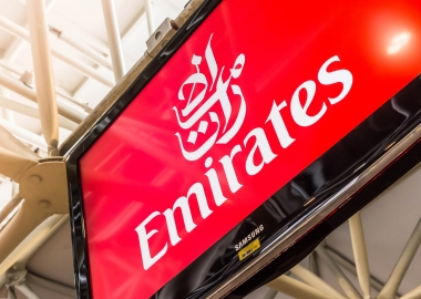 Emirates logo on a TV screen at an airport