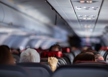 Passengers on aircraft holding airplane seat aerotime news