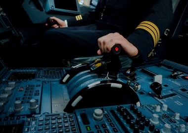 Pilot captain adjusting thrust levels of an aircraft engine
