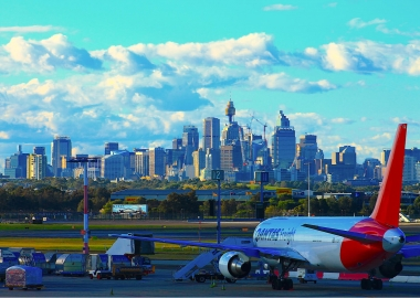 Qantas plane with the Sydney cityscape in the background aerotime